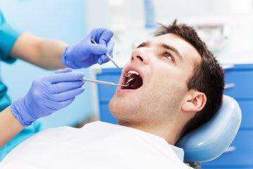man during dental exam in austin
