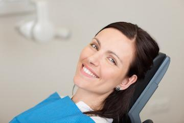 woman smiling sitting in dental chair