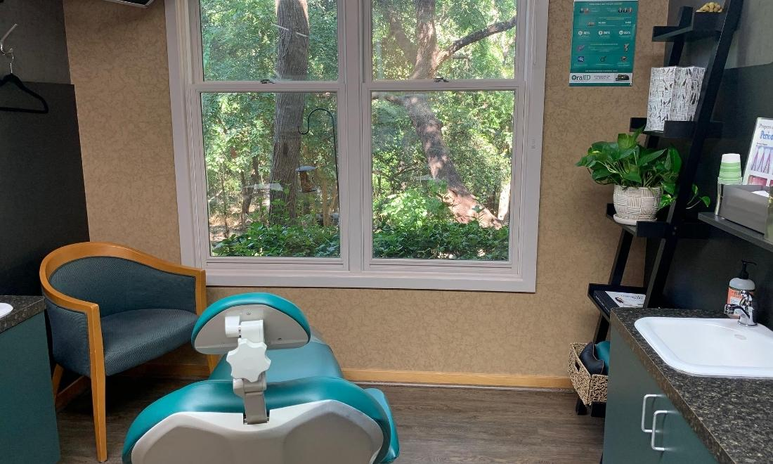 A comfortable treatment room with views of bird feeders and the greenbelt